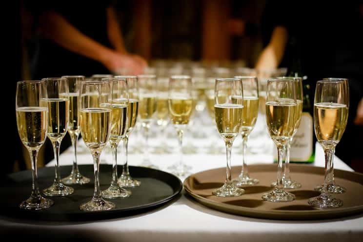Table lined up with glasses of champagne