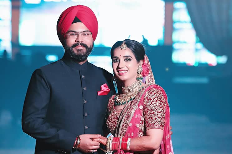 Sikh groom and Sikh bride posing for photos